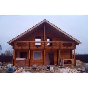 Дом из бревна ручной рубки или оцилиндрованного бревна